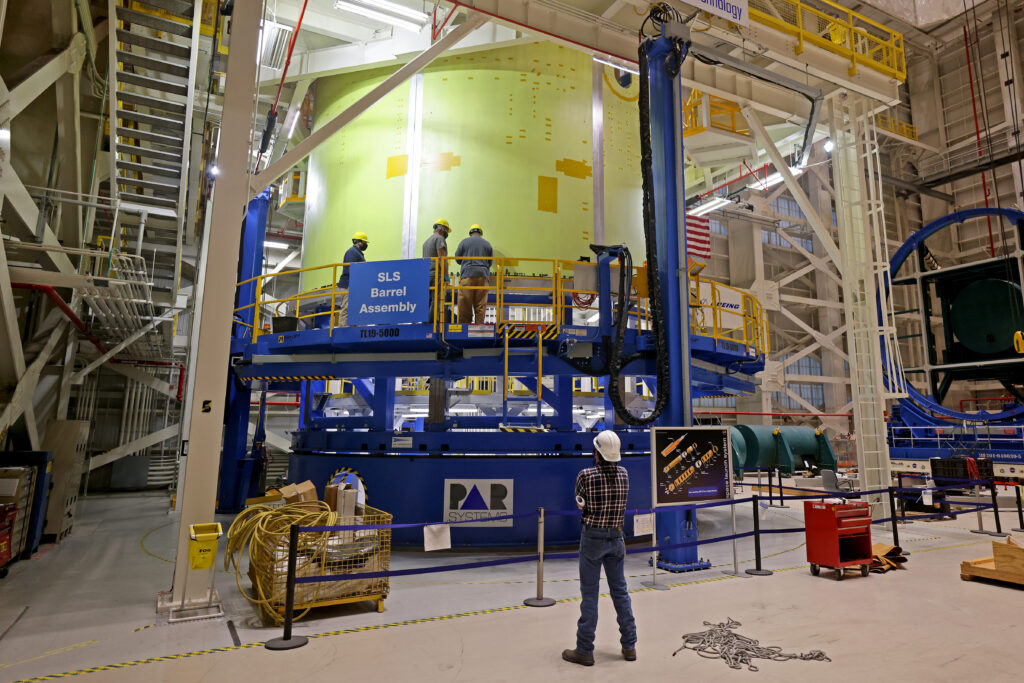 January 2021 - The final panel is lifted into place on a CS3 engine section barrel assembly inside Building 115 of the NASA Michoud Assembly Facility on Thursday, January 7, 2021.