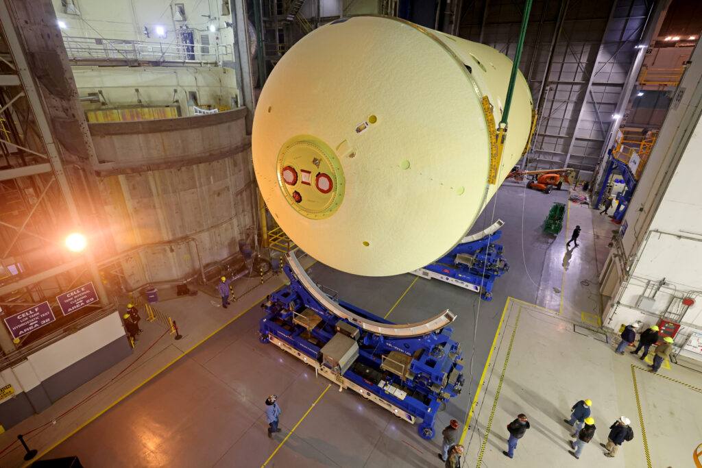May 2021 - This image highlights the liquid oxygen tank, which will be used on the core stage of NASA' Space Launch System rocket for Artemis II, the first crewed mission of NASA's Artemis program, at NASA's Michoud Assembly Facility. The SLS core stage is made up of five unique elements: the forward skirt, liquid oxygen tank, intertank, liquid hydrogen tank, and the engine section. The forward skirt houses flight computers, cameras, and avionics systems. The liquid oxygen tank holds 196,000 gallons of liquid oxygen cooled to minus 297 degrees Fahrenheit. The LOX hardware sits between the core stage's forward skirt and the intertank. Along with the liquid hydrogen tank, it will provide fuel to the four RS-25 engines at the bottom of the core stage to produce more than two million pounds of thrust to launch NASA's Artemis missions to the Moon.     Together with its four RS-25 engines, the rocket's massive 212-foot-tall core stage — the largest stage NASA has ever built — and its twin solid rocket boosters will produce 8.8 million pounds of thrust to send NASA's Orion spacecraft, astronauts and supplies beyond Earth's orbit to the Moon and, ultimately, Mars. Offering more payload mass, volume capability and energy to speed missions through space, the SLS rocket, along with NASA's Gateway in lunar orbit, the Human Landing System, and Orion spacecraft, is part of NASA's backbone for deep space exploration and the Artemis lunar program. No other rocket can send astronauts in Orion around the Moon in a single mission. Image credit: NASA/Michael DeMocker