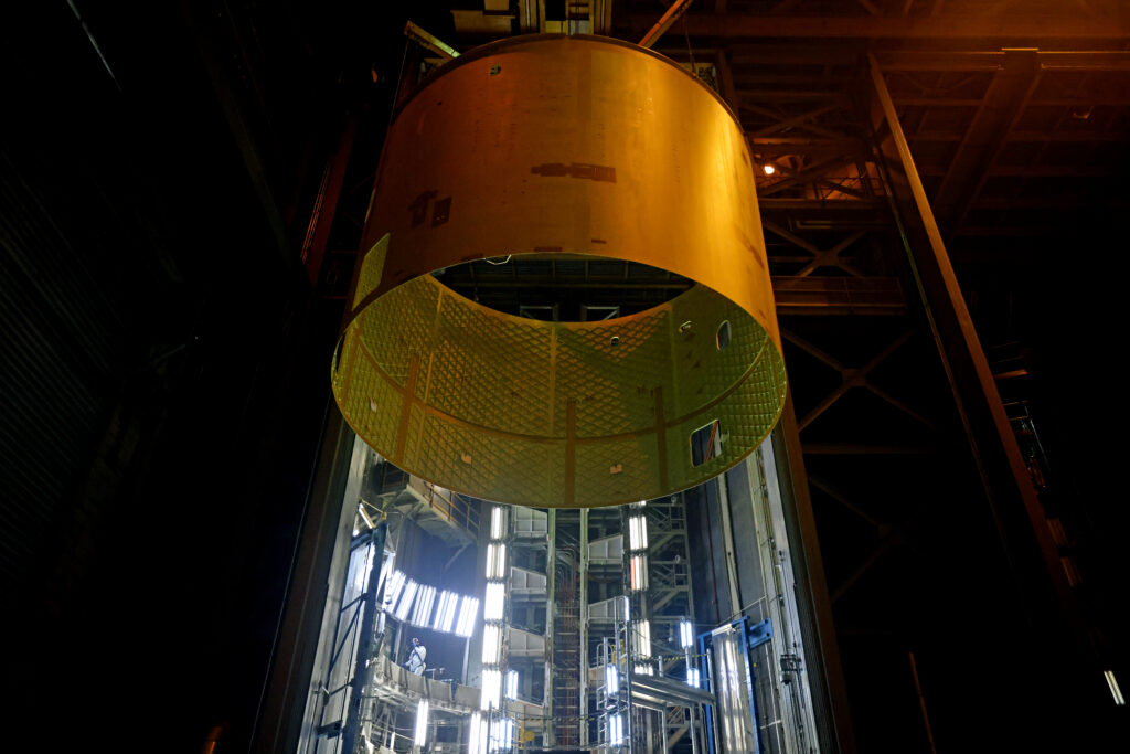 June 2021 - The Artemis III engine section is lifted out of Cell G in Building 114 at NASA Michoud Assembly Facility. Image credit: NASA/Michael DeMocker