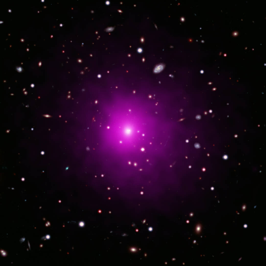 This image of Abell 2261 contains X-ray data from Chandra (pink) showing hot gas pervading the cluster as well as optical data from Hubble and the Subaru Telescope that show galaxies in the cluster and in the background. Astronomers used these telescopes to search galaxy in the center of the image for evidence of a black hole, weighing between 3 and 100 billion times the Sun, that is expected to be there. No sign of this black hole was found, deepening a mystery about what is happening in this system.