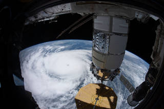 iss065e327057 (Aug. 29, 2021) --- Hurricane Ida is pictured as a category 4 storm nearing the southeast Louisiana coast from the International Space Station. In the foreground, is the Northrop Grumman Cygnus space freighter attached to the Unity module.