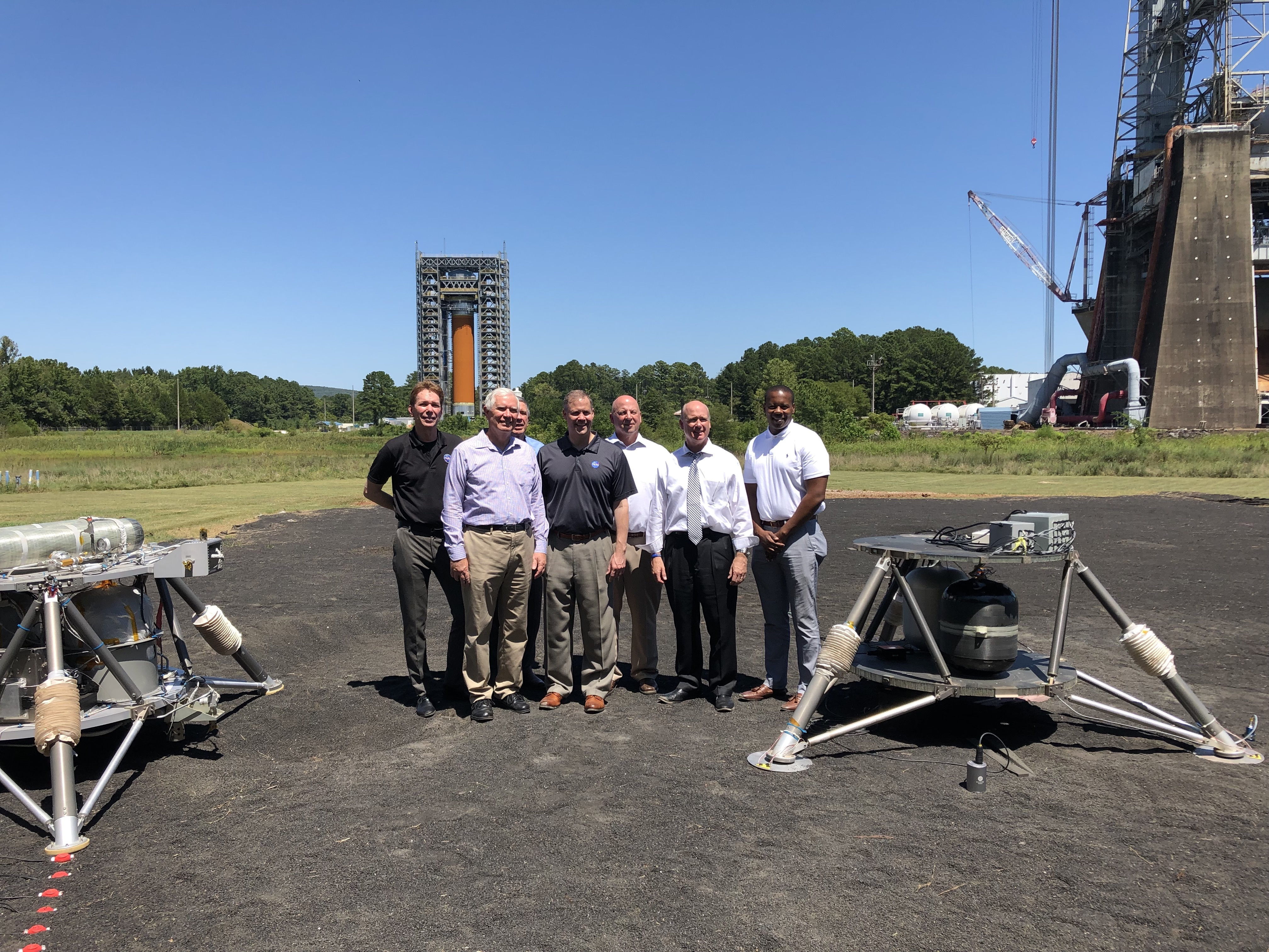 NASA Administrator Jim Bridenstine, Rep. Mo Brooks, Rep. Robert Aderholt, Rep. Scott DesJarlais, and others at the lunar regolith testbed.